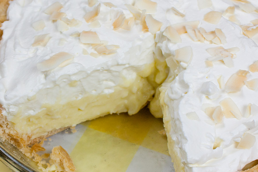 Coconut Cream Pie with slice removed