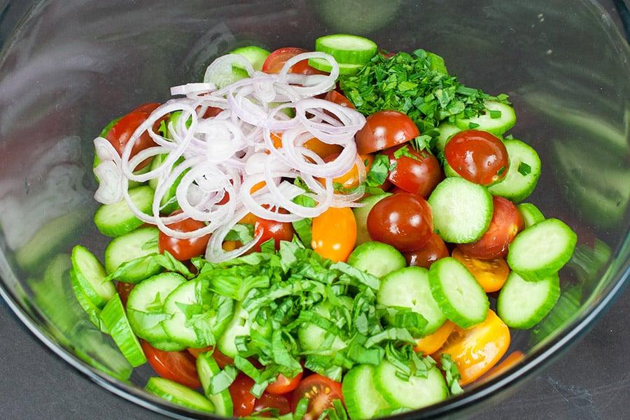 Tomato Cucumber Feta Salad - The best tomato cucumber feta salad ever! A quick, fresh, light, crunchy, flavorful and addictive salad!