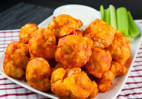 Baked Buffalo Cauliflower Bites - Crispy on the outside and just tender enough on the inside.The vegetarian buffalo wing!