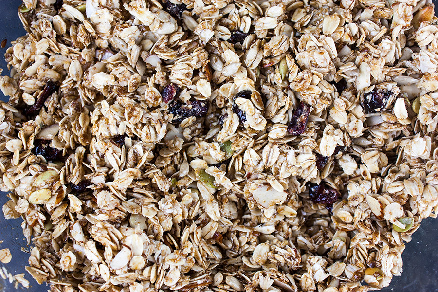 granola mixed in a glass mixing bowl