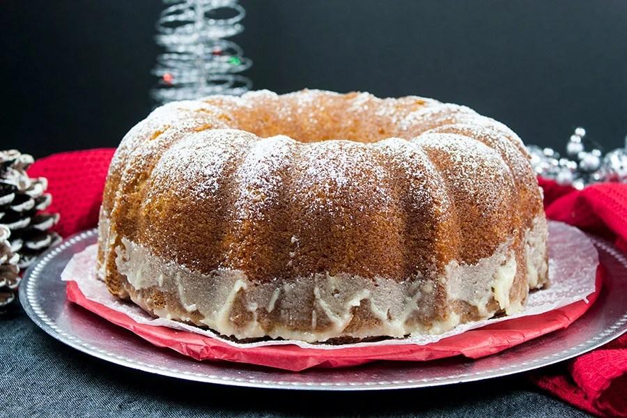 eggnog bundt cake on silver and red plates