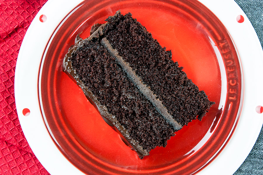 slice of cake dark chocolate espresso cake on red plate