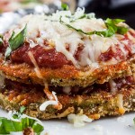 Sheet Pan Eggplant Parmesan - An easier and healthier version of an Italian classic. Crispy baked eggplant topped with tangy marinara sauce and smothered in creamy melted mozzarellacheese!