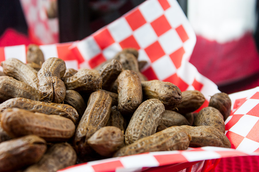 boiled peanuts in red basket with red and white checkered paper liner
