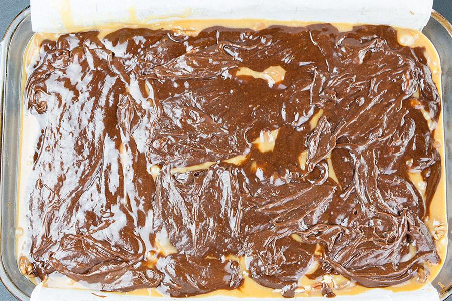 remaining brownie batter spread over the caramel pecan layer