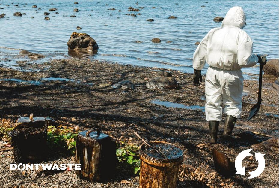 Volunteer shoveling oil