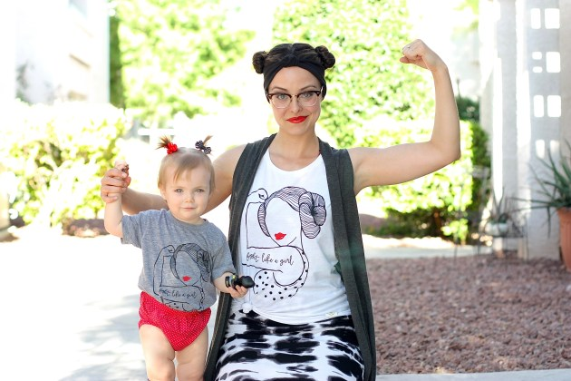 """Mom and Daughter wearing Shirts from WIRE AND HONEY that have a Pinup Princess Leia posing like Rosie the Riveter on them and say """"Fight like a girl."""""""