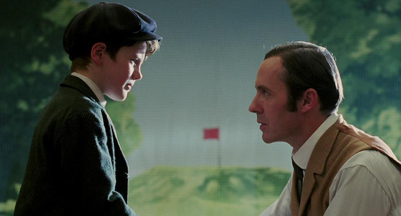 "Close up scene from the movie ""The Greatest Game Ever Played"" where Harry Vardon comforts young Francis Ouimet after he fails to hit the golf ball by reminding him he must never despair and asks him if he's ever held a live bird in his hands."