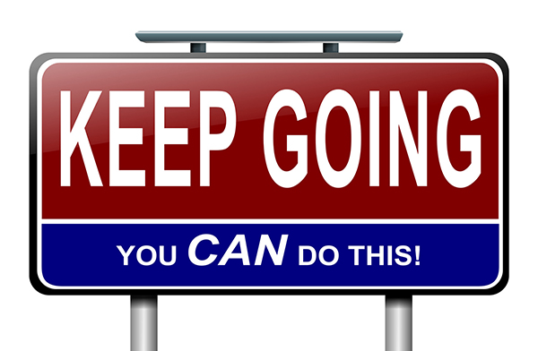 "Illustration of a sign saying ""Keep going, you CAN do this,"" illustrating how vital it is for dyslexic children to learn how to have grit."
