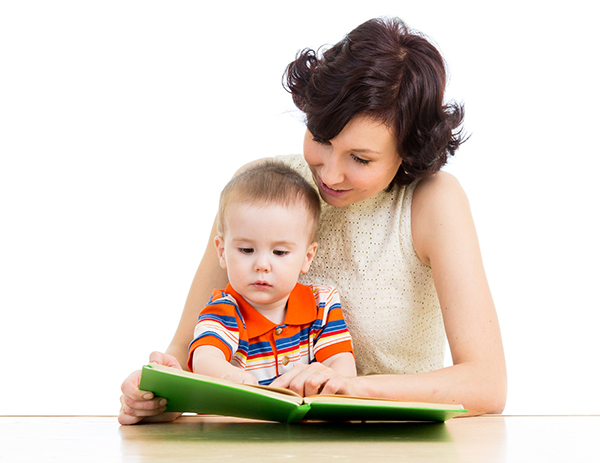 A mother reads to her toddler. Shared reading starting at an early age is beneficial for all children, but especially children who are later diagnosed with dyslexia. Find out why in Don M. Winn's latest book Raising a Child with Dyslexia: What Every Parent Needs to Know.