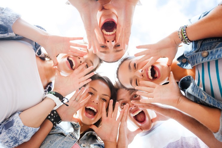 summer holidays and teenage concept - group of teenagers looking