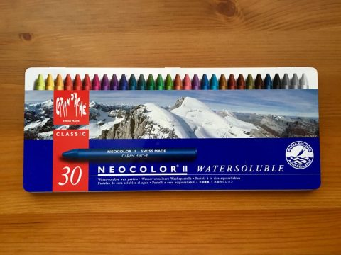 Top view of metal tin of Caran D'Ache Neocolor II water-soluble was oil pastels