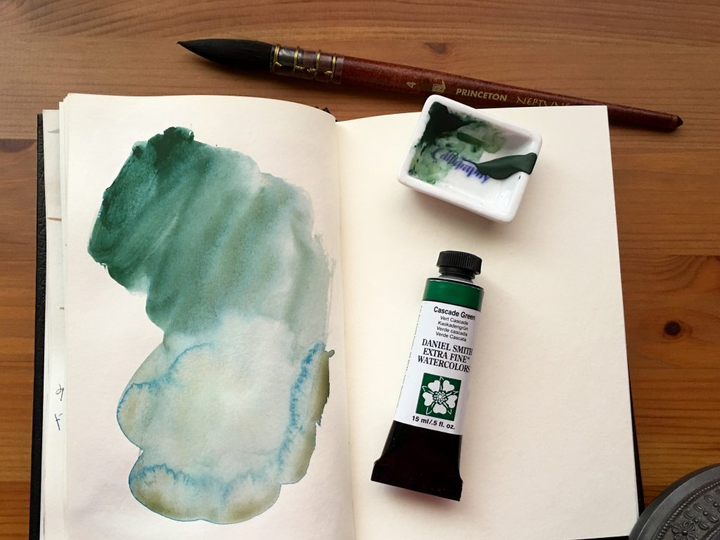 Daniel Smith Extra Fine watercolors paint swatches of Cascade Green in a stillman and birn gama series journal with a Princeton Neptune size 4 quill brush