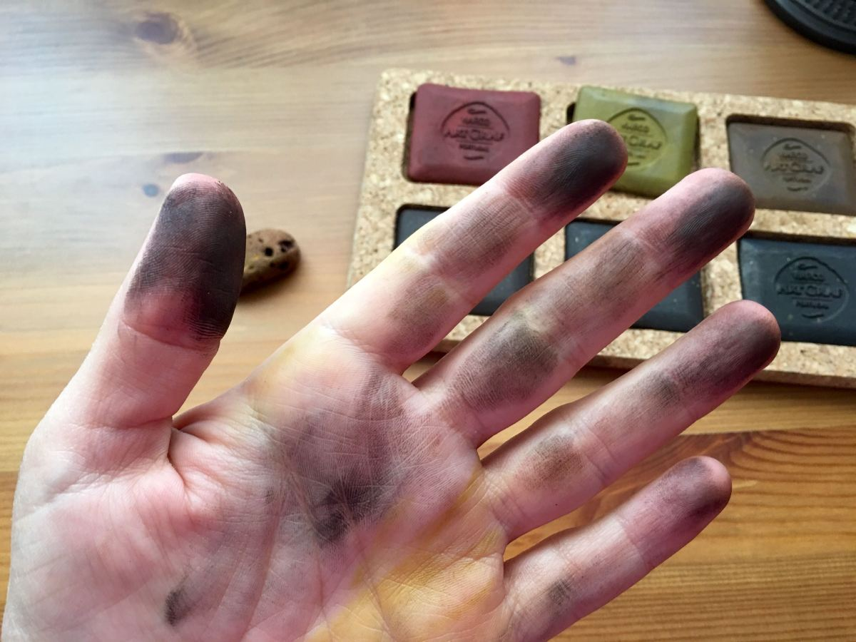 ArtGraf Tailor Chalks, which comes in six different colors- Sanguine, Ochre, Sepia, Brown, Dark Brown and Carbon Black on hands