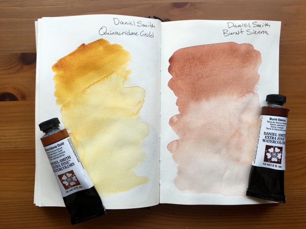 Daniel Smith Extra Fine watercolors paint swatches of Quinacridone Gold and Burnt Sienna in a stillman and birn gama series journal