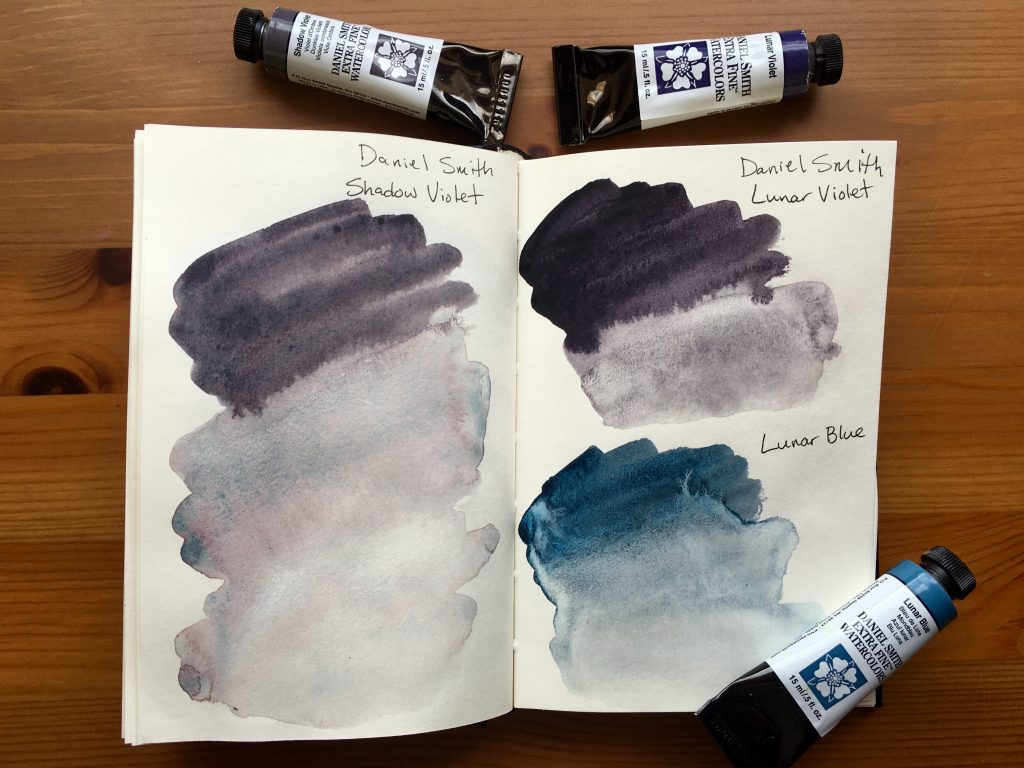 Daniel Smith Extra Fine watercolors paint swatches of Shadow Violet, Lunar Violet and Lunar Blue in a stillman and birn gama series journal
