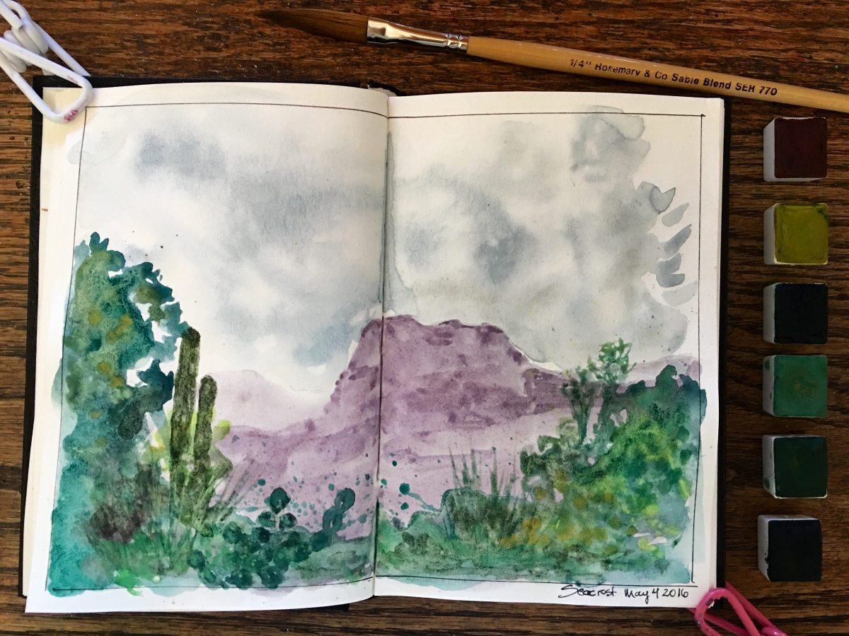 Greenleaf & Blueberry handmade watercolor painting using Mayan Blue, Mayan Violet, Mayan Green, Mayan Yellow, Purple Ochre, Yellow Ochre, Malachite, Green Earth, Celadonite, Violet Hematite, Slate. The brush in the photo is a Rosemary & Co. Series 770 in a Stillman & Birn Gamma Series