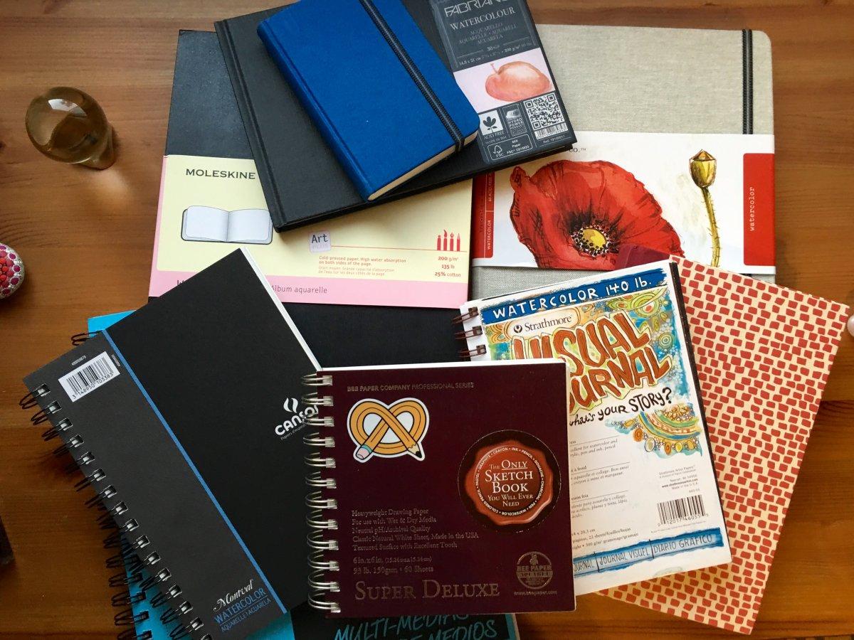 Pile of journals, sketch, watercolor, Pocket Moleskin Art Plus Watercolor, moleskine, travelogue, handbook, fabriano Venezia , strathmore Montval, bee paper compnays super deluxe, canson XL