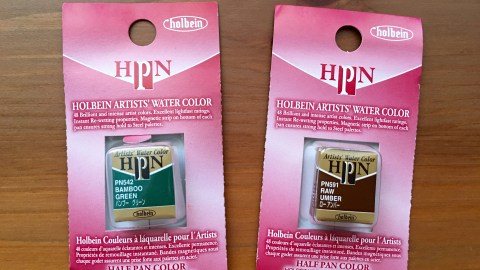 Holbein artists' water color pans in bamboo green and raw umber