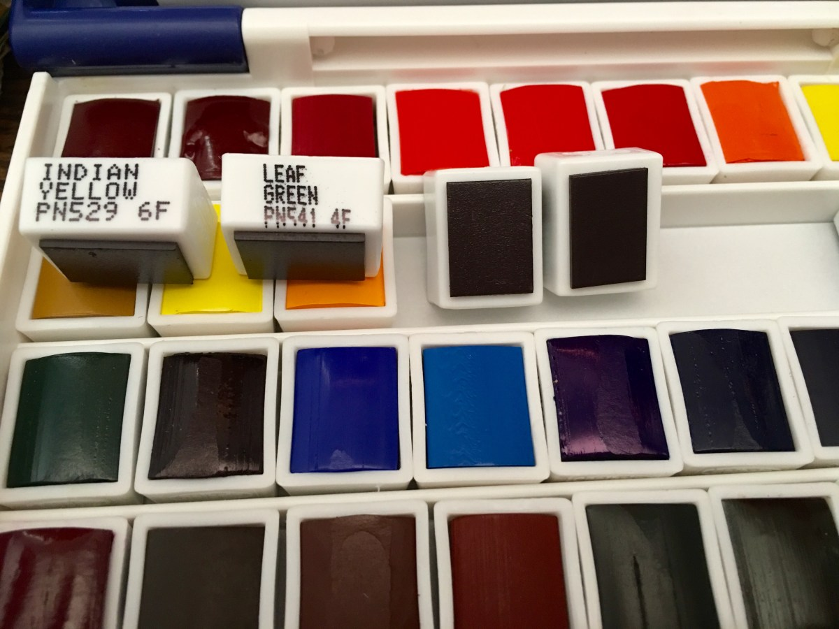 Holbein Palm Box Plus watercolor pans with printed color names
