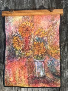 Here is a watercolor batik on Ginwashi paper, quilted and beaded. The drawing is by Kathie George. 7