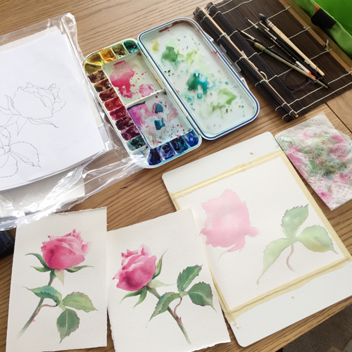 Studio setup of painting a rose in watercolor