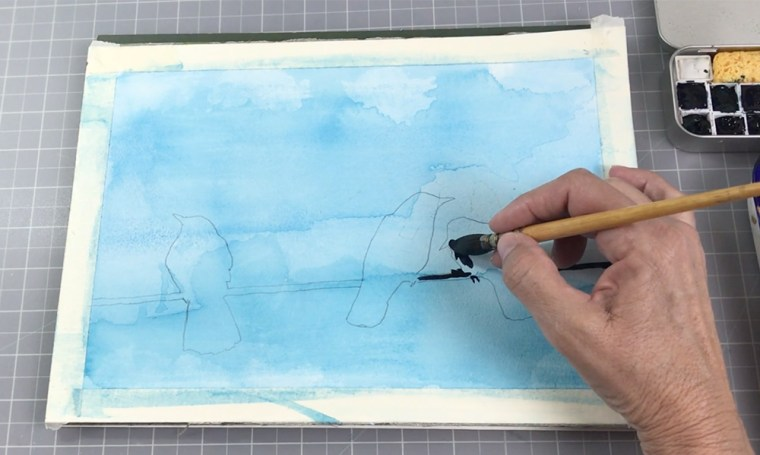 Painting silhouettes birds on a watercolor background