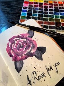 Quick, loose rose in a handmade, leather journal, the paper is lovely but very soft and thin. No gra