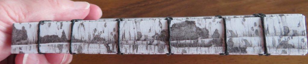 Handmade watercolor sketchbook spine detail