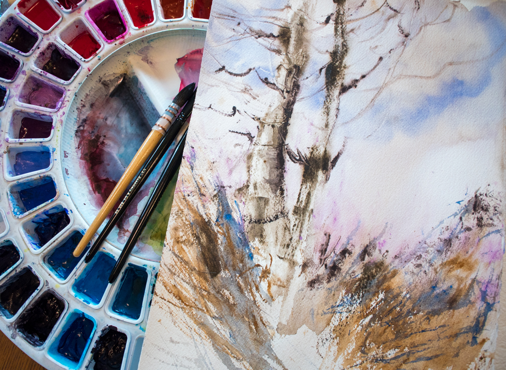Watercolor birch trees painting by Angela Fehr and circular watercolor palette