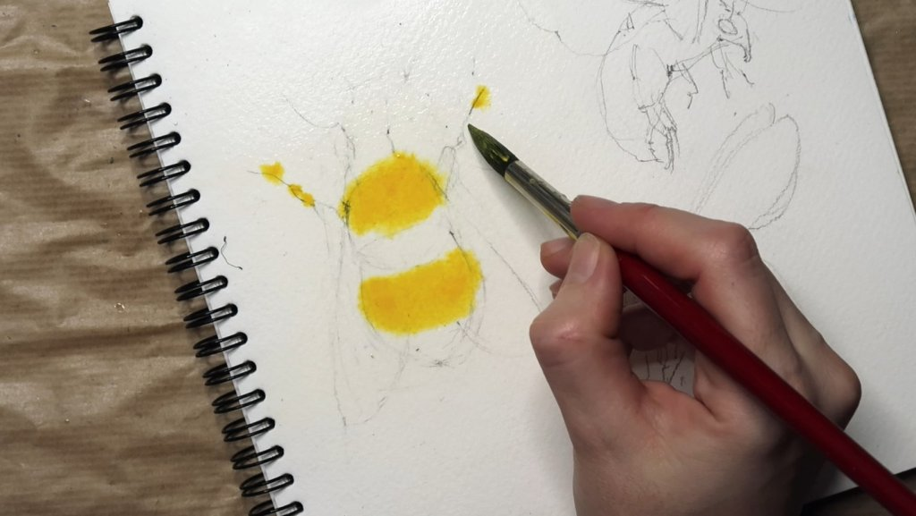 Adding yellow paint bees in gouache