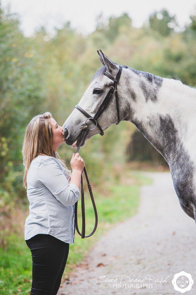 girl kissing her horse