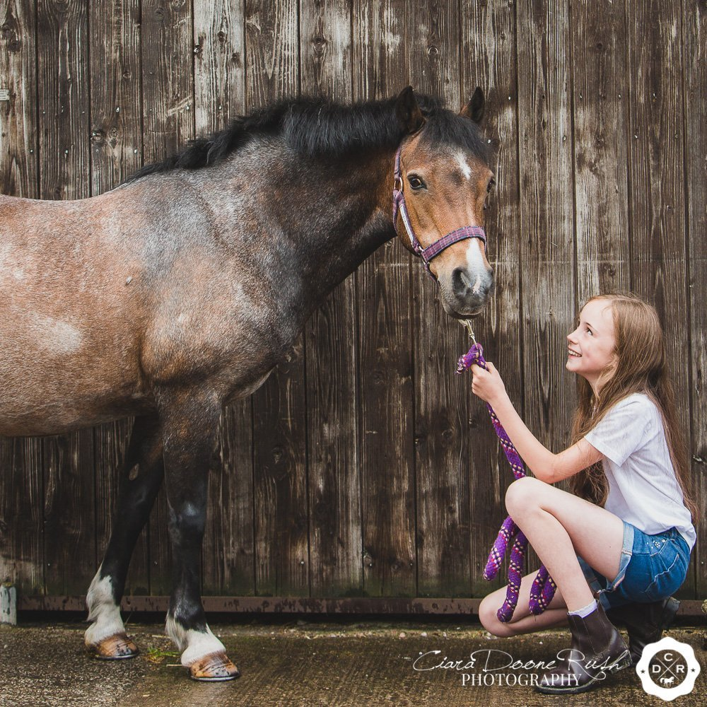 a kid and her pony