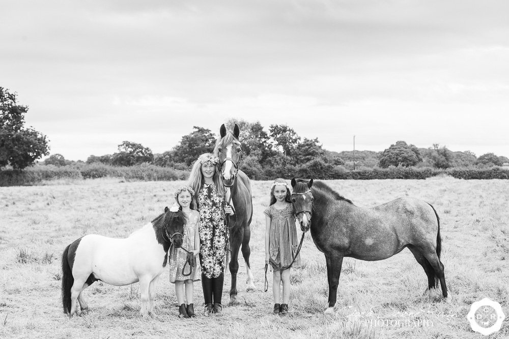 Kids and ponies in a field