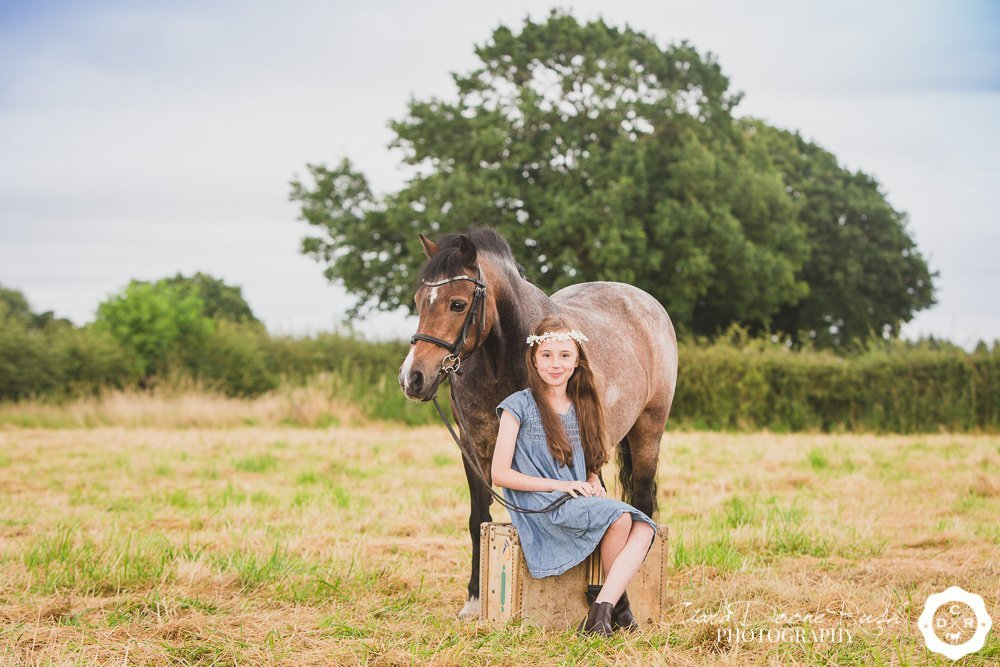 A child and her pony