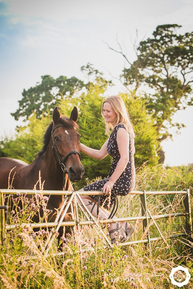 a woman and her bay gelding