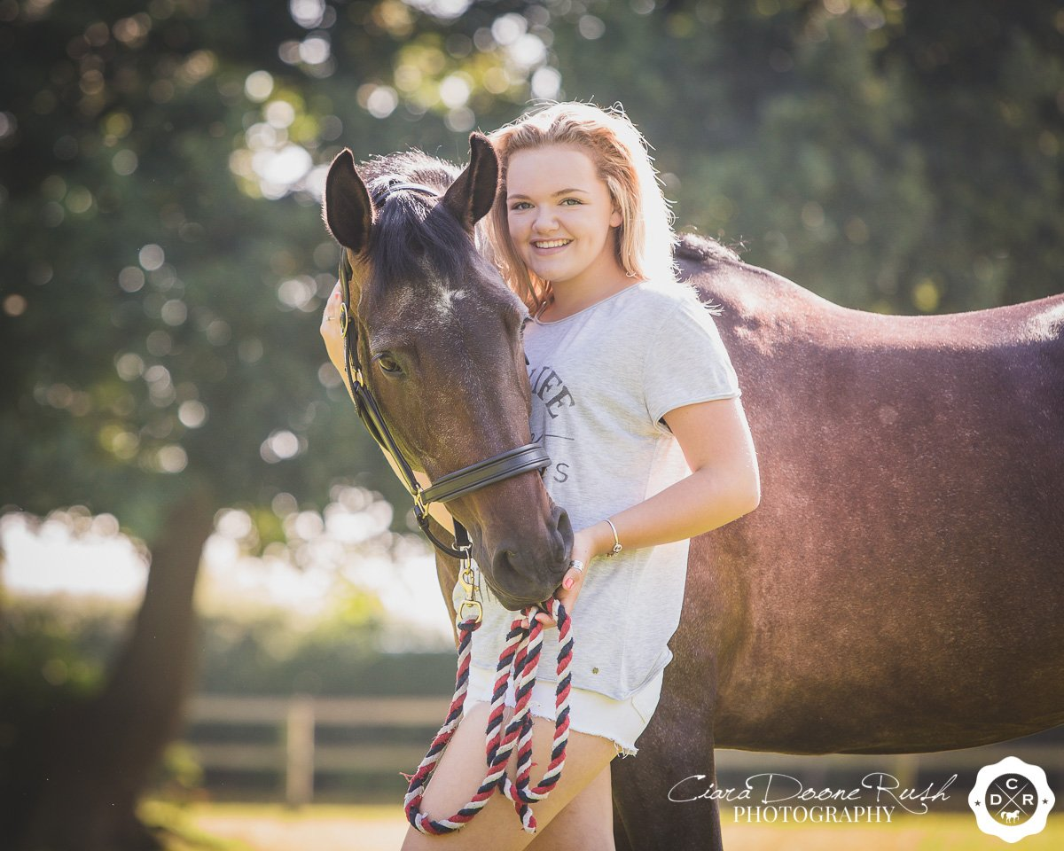 a girl and her pony prepared for a photo shoot