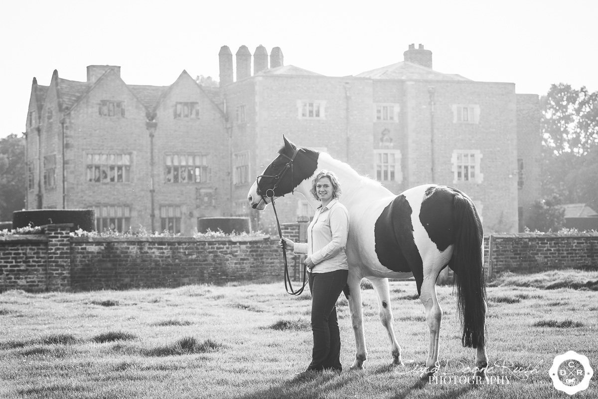 a woman and her horse on a photo shoot