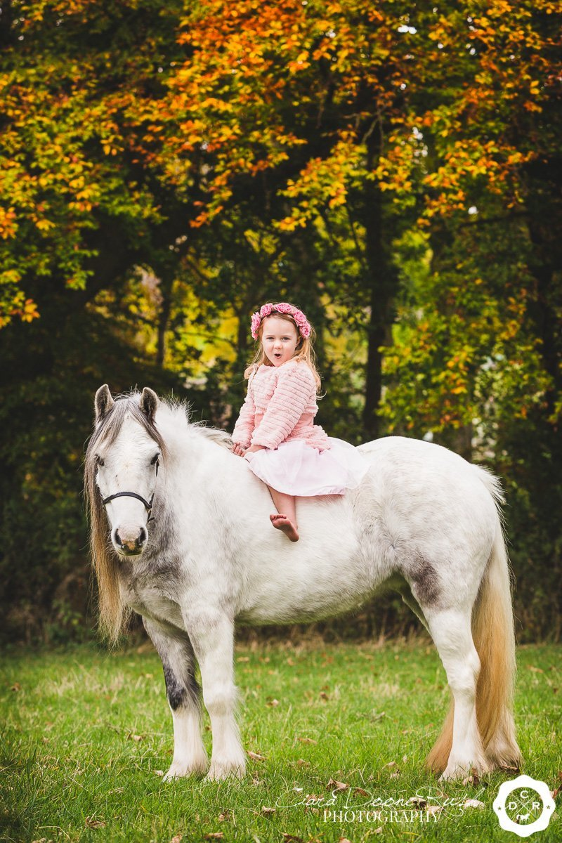 a little girl and her pony on a photo shoot in north wales