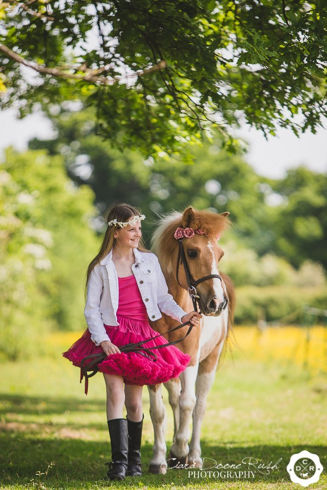 little girl in pink with her pony