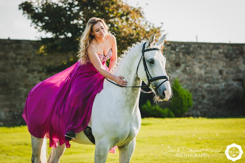 a girl on her horse in a ball gown