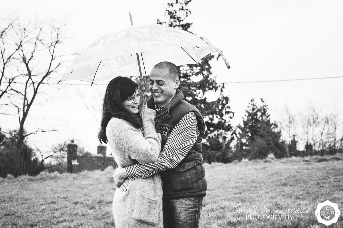 a couple on a photo shoot in the rain