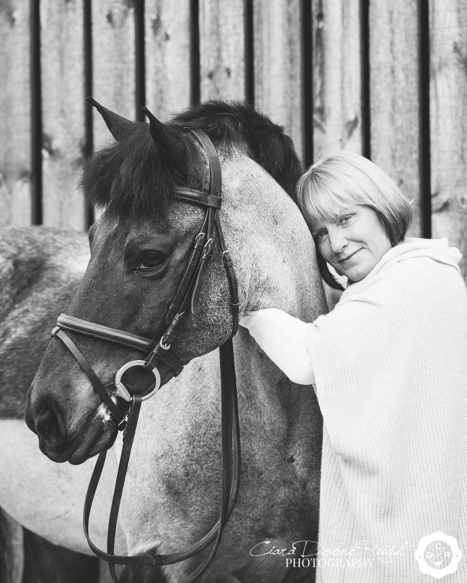 black and white horse and rider portrait