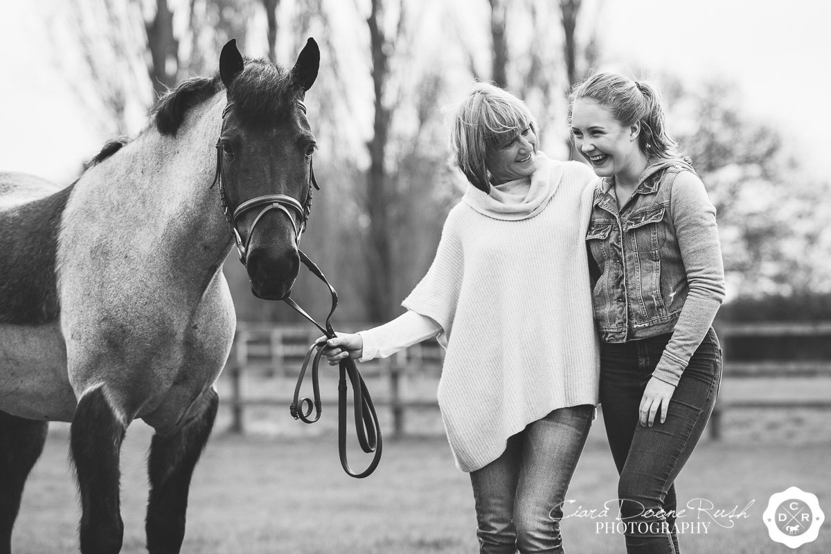 mother and daughter giggling on photo shoot with Dylan the pony