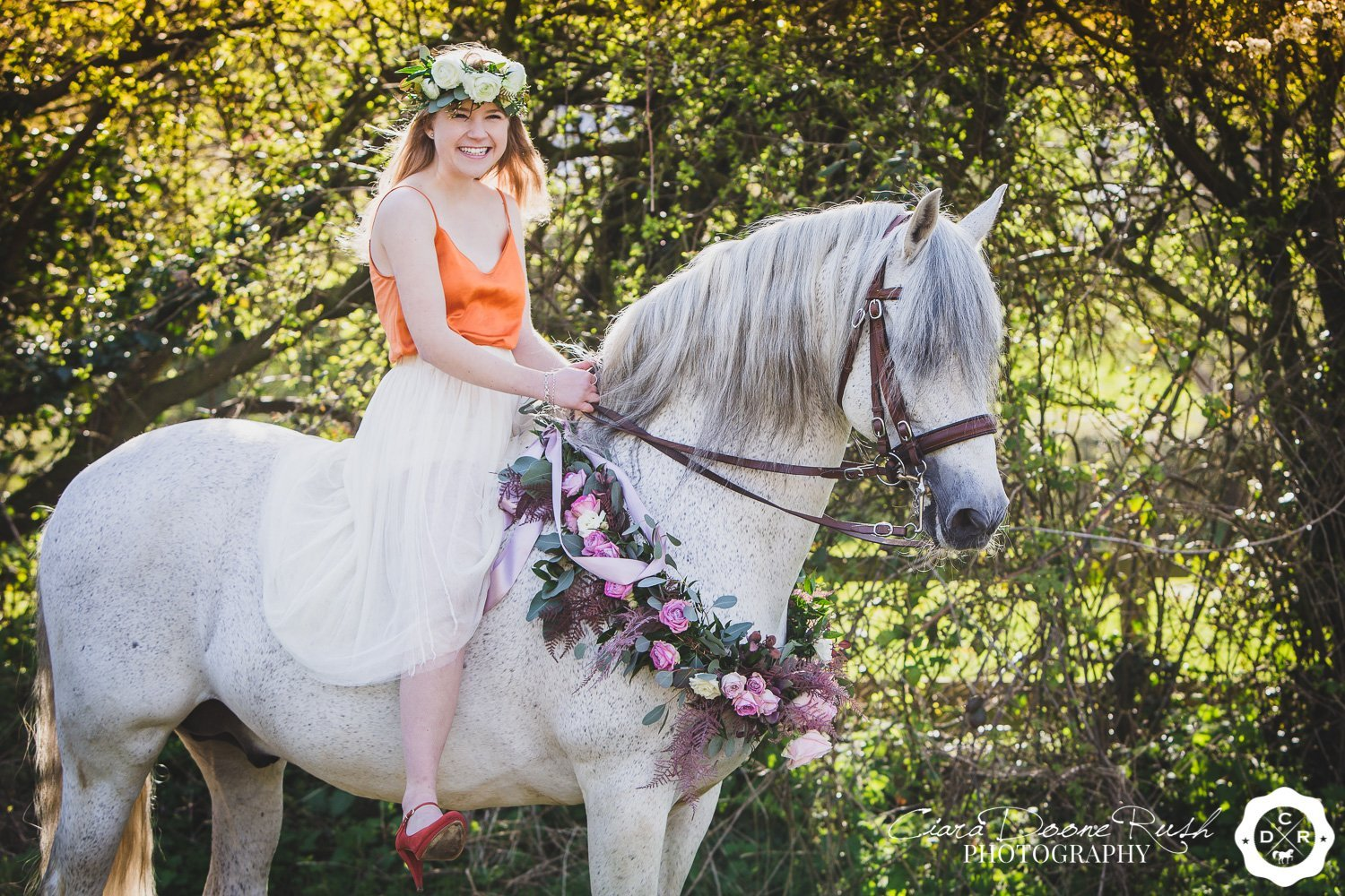 a girl and her horse with flowers