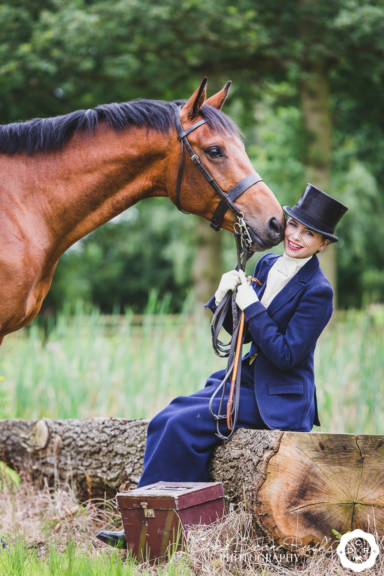 A girl in a vintage habit on a horse and rider photo shoot