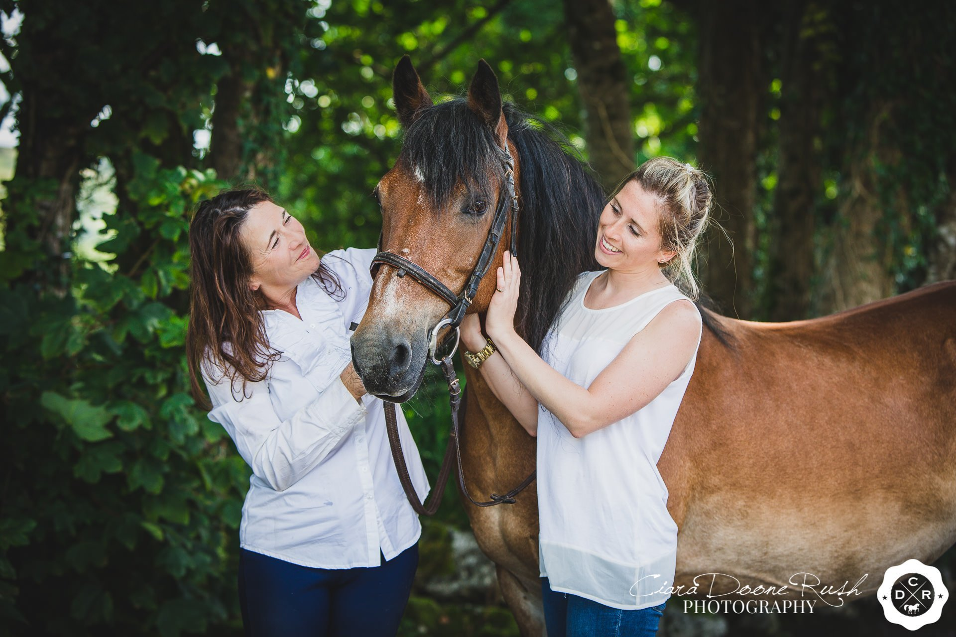 A mum and daughter with their pony on a horse and rider photo shoot