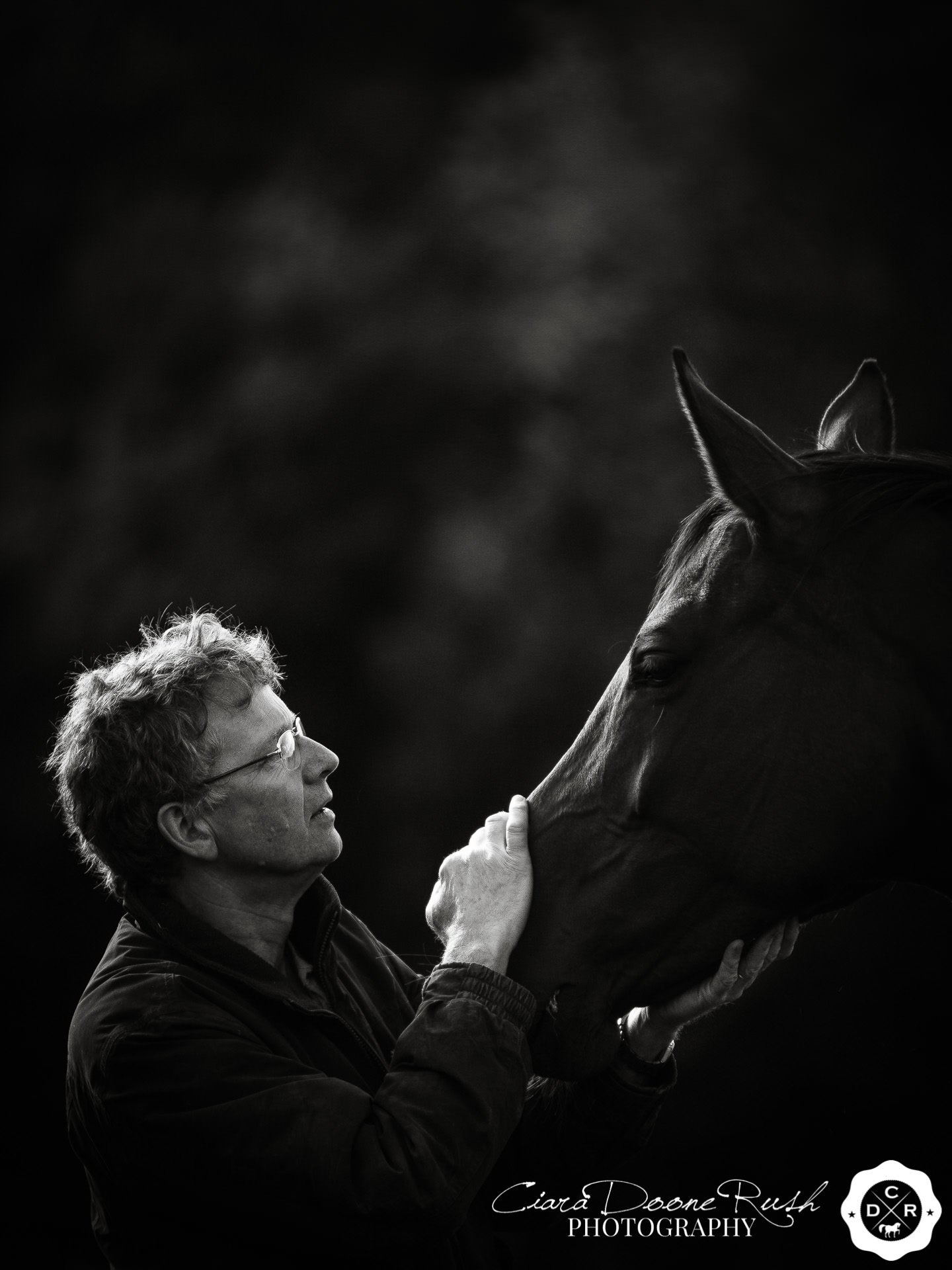 A man and his horse on a horse and rider photo shoot
