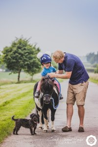 a dad and his daughter on a family and animal photo shoot