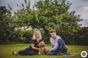siblings and their dog on a family photo shoot